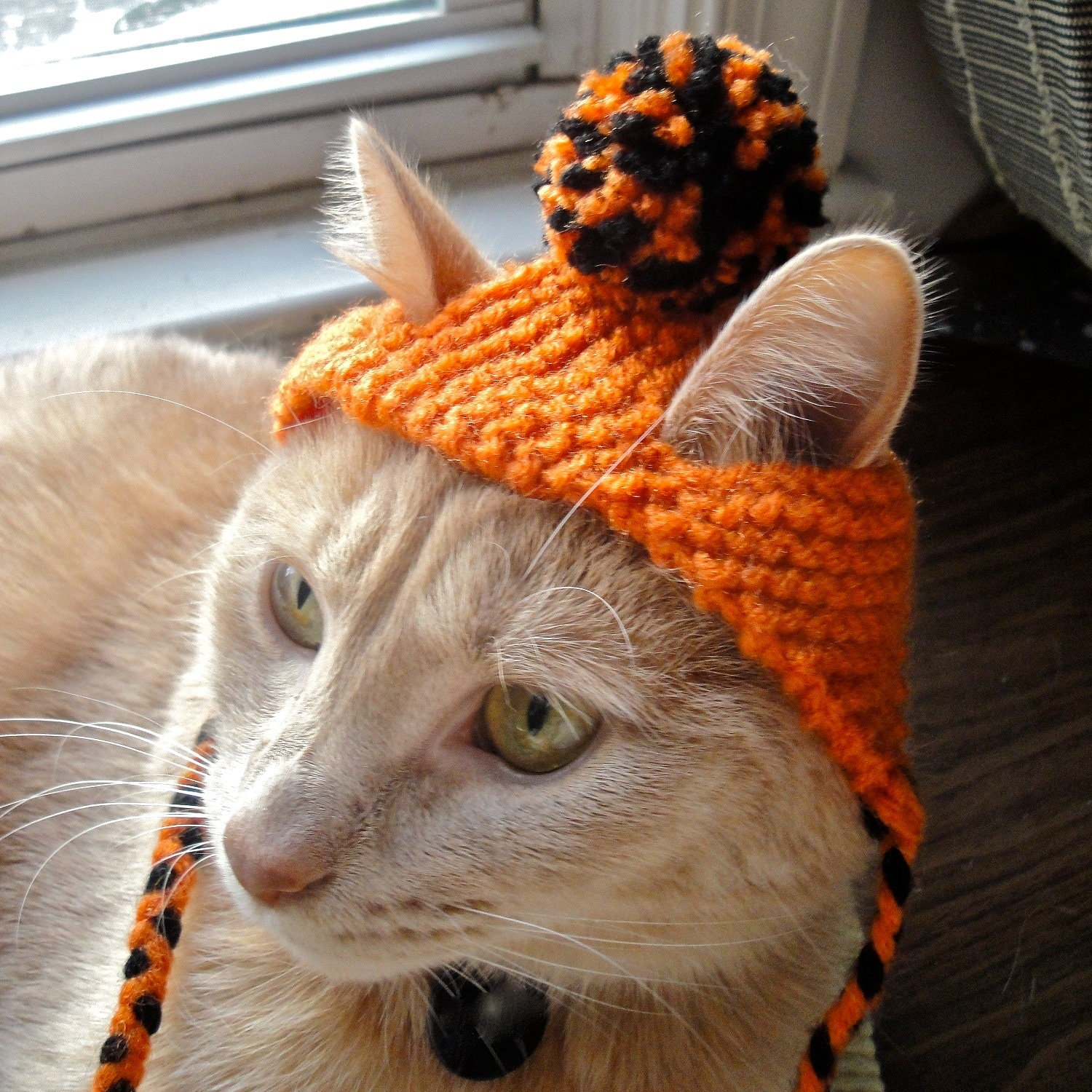 orange and black knitted halloween cat hat
