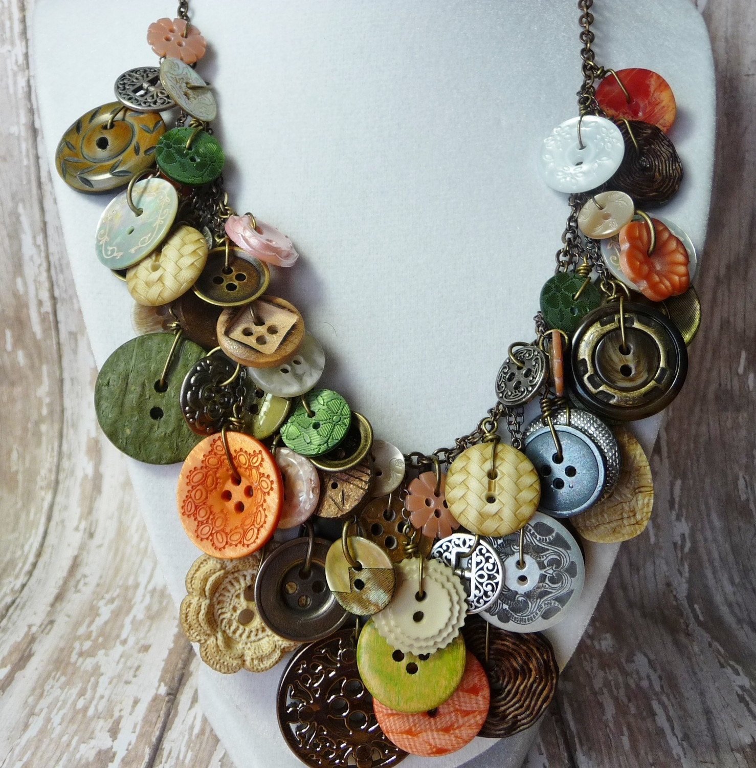"Bountiful Buttons - Moss Green/Salmon/Oatmeal buttons on brass chain - Nominated for ""Design of the Year"""