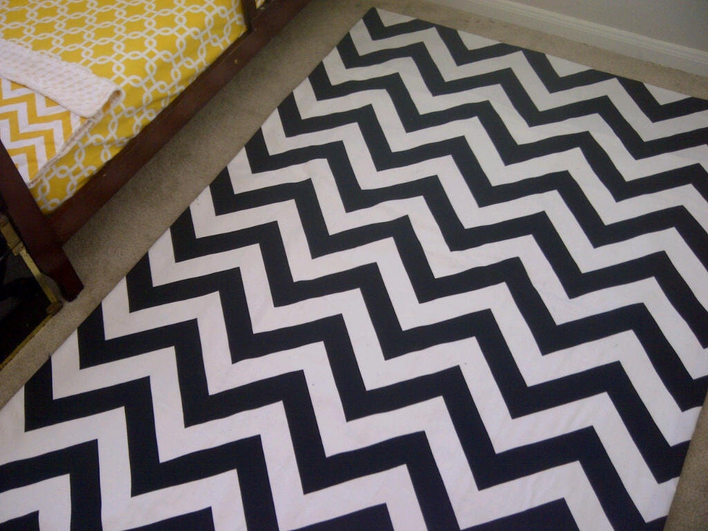 Woven area rug in a Modern and Classy black and white Chevron stripe in 4 ft by 6ft