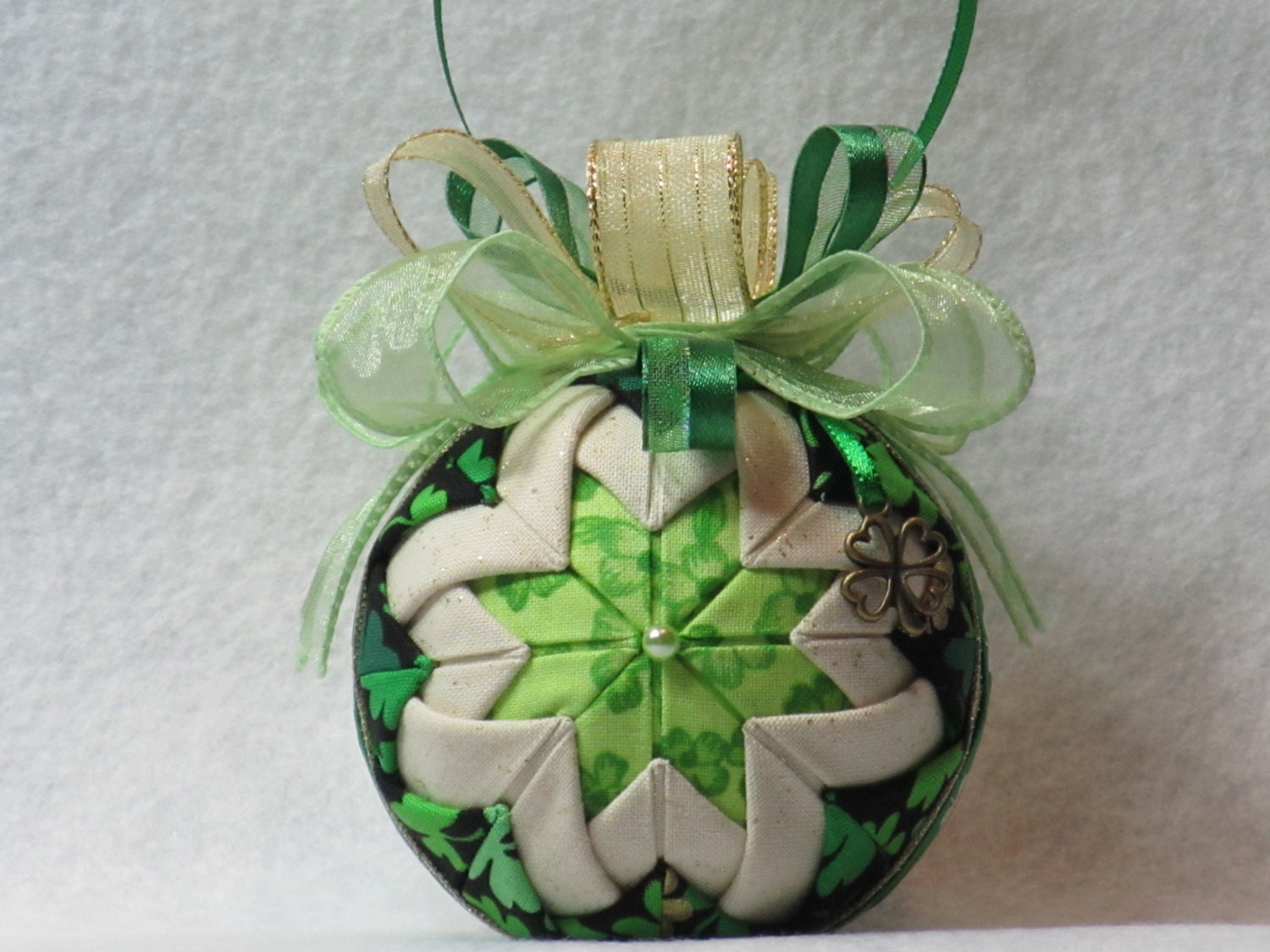 Quilted no sew fabric St. Patrick's Day ornament - black/green/gold shamrock fabric, shamrock ribbon, green & gold bow, with Shamrock charm