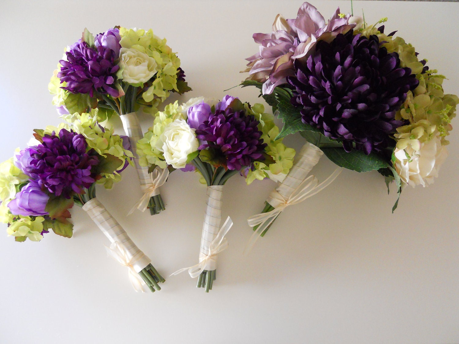 green and purple winter wedding bouquets