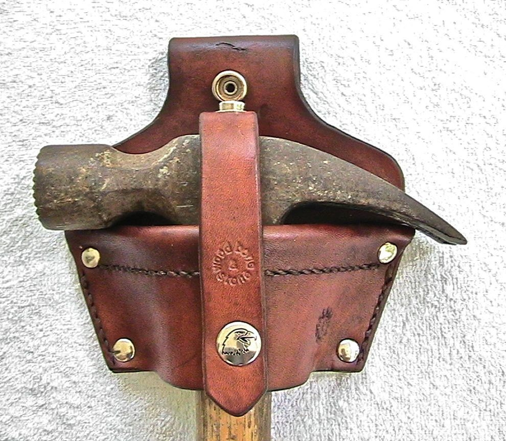 Leather hammer holster with security strap. - WoodBoneAndStone