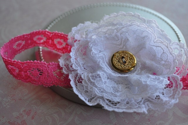 Lacee. White lace flower headband on hot pink stretch lace