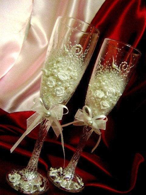 Hand decorated wedding champagne glasses toasting flutes in ivory and white