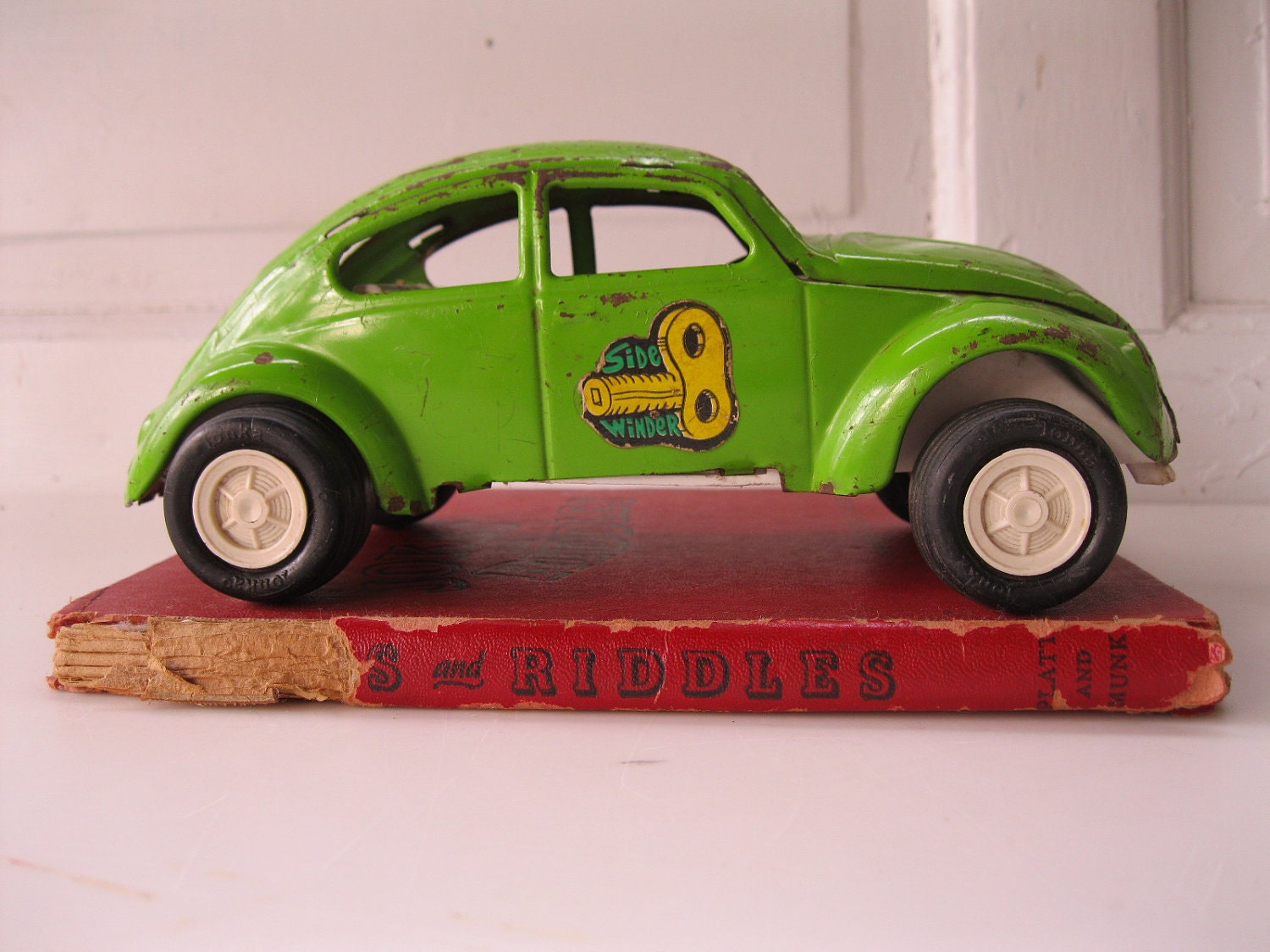 Lime green vintage VW bug toy car