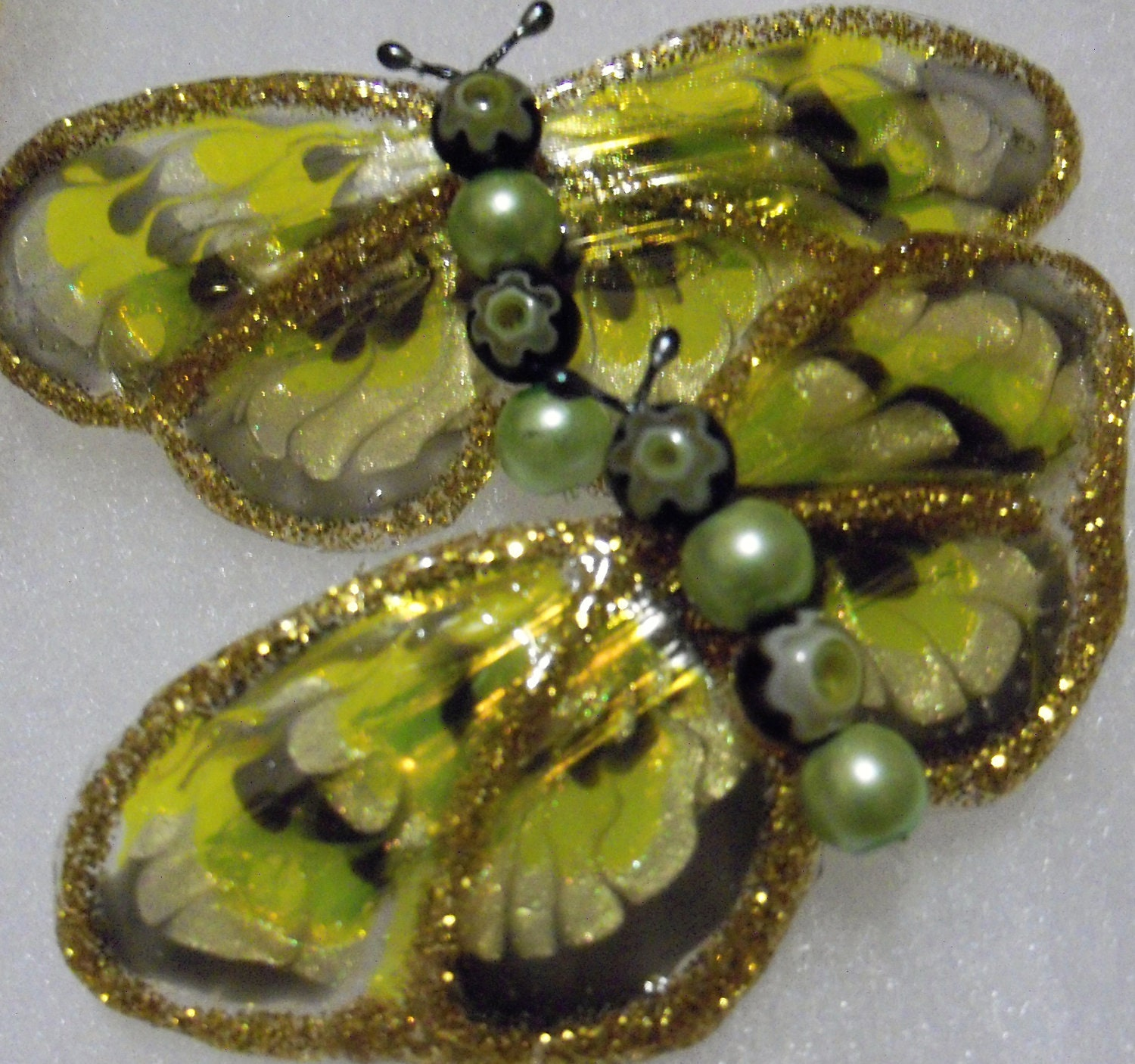 pair of small green butterfly barrettes
