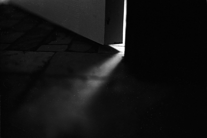 Door Cracks// 35mm Black and White Capture - LWestermanPhoto
