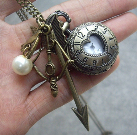 The Hunger Games Inspired Arrow,bow, Mockingjay and Pearl Heart Roman numerals Pocket watch Locket Necklace