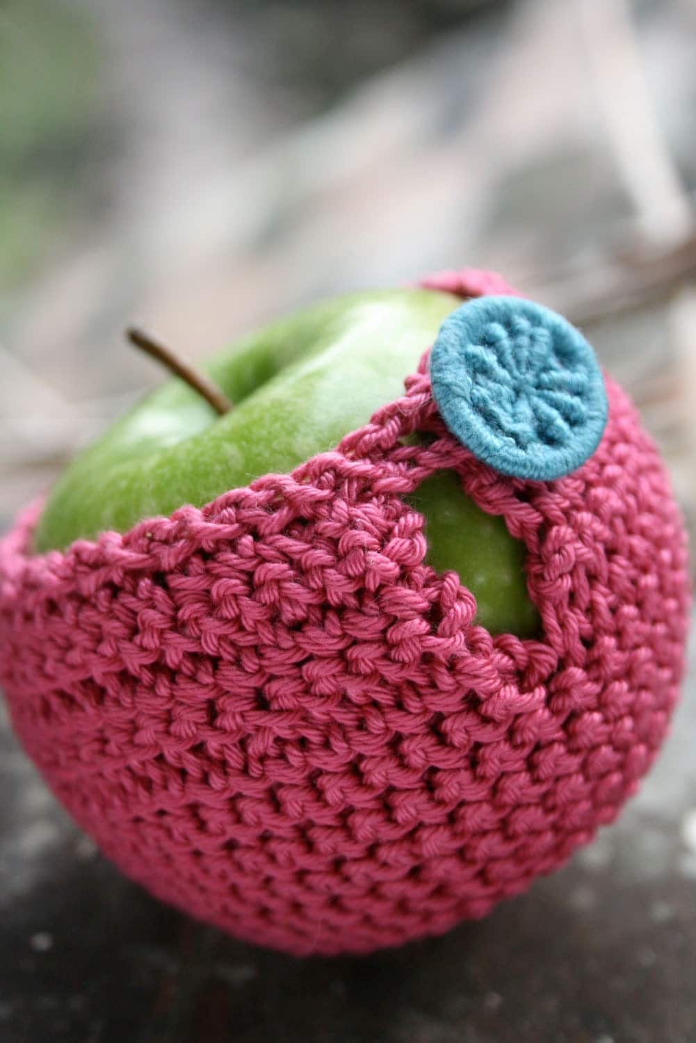 Apple cozy crocheted in pure cotton yarn with a Dorset button