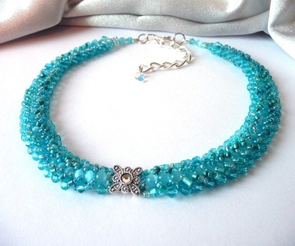 eye ocean blue Czech beads and dotted with hints of turquoise sea green