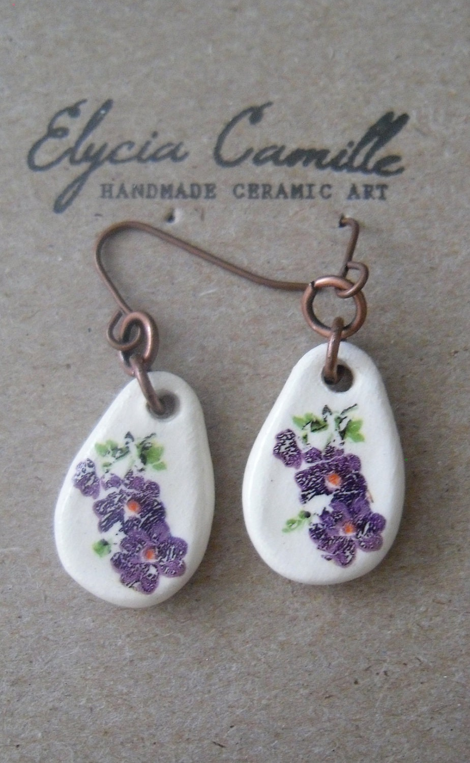 handmade ceramic earrings, dangle, purple flowers, antique copper colored fish hooks