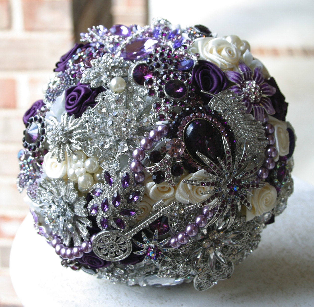 Purple  & ivory brooch bouquet. Deposit on a made to order bridal bouquet