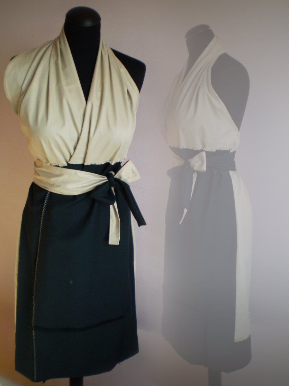 black and beige wrap dress with a belt and open back