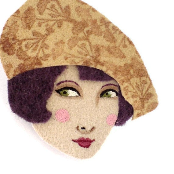 Fabric brooch - Amelie , Girl with a floral beret, Autumn, wearable art, gold buff, deep purple, brown, woman face