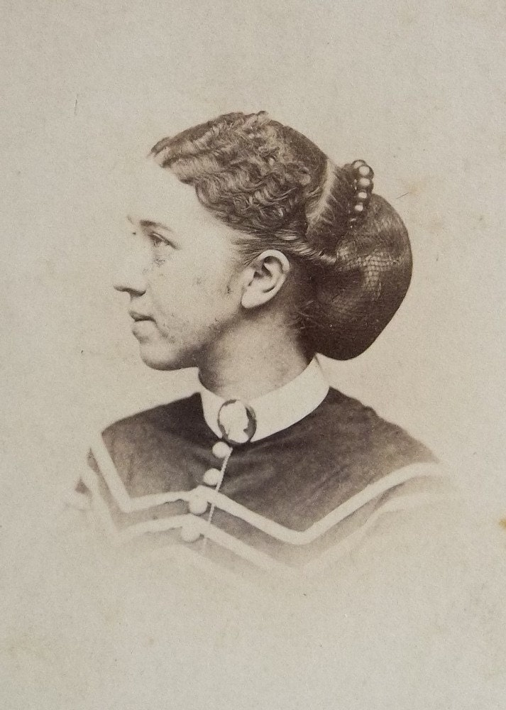 very old photograph of lady wearing antique hair adornment