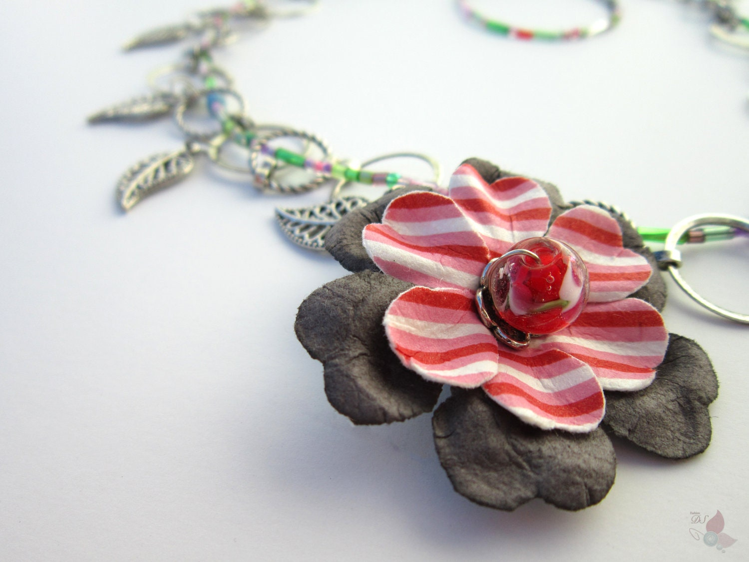 On Sale Necklace with Flower on the Side and Dangling Leaves and a Seed Bead Thread
