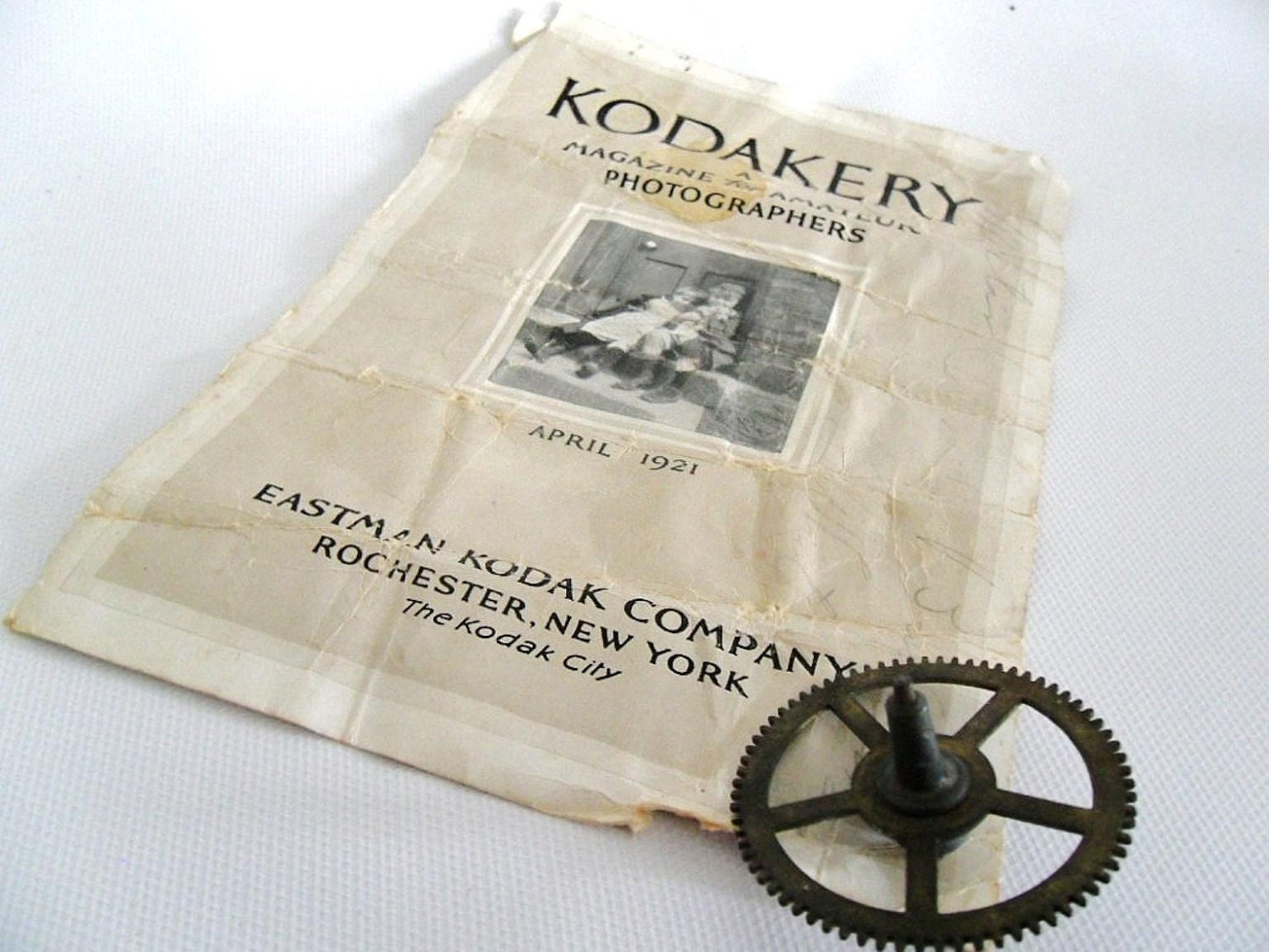 WB - 1921 Brass Photo Gear and Kodak Advertisement - owlsongvintage