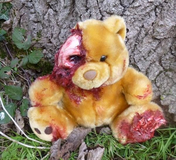 Sitting UnDead Ted with exposed skull, eyesocket, arm bones & foot bones.