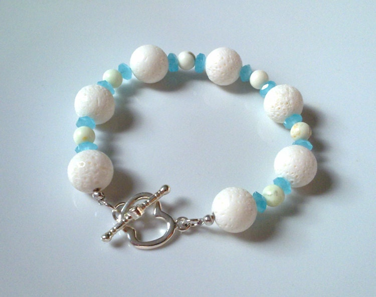 Handmade, delicate bracelet with white corals, lime stone and apple shaped clasp