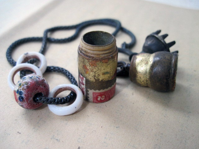 How to End an Era. Rustic Gypsy Assemblage Pendant. Gilded and Papered Wooden Saint Container Pendant with Tribal bell and Lampwork..