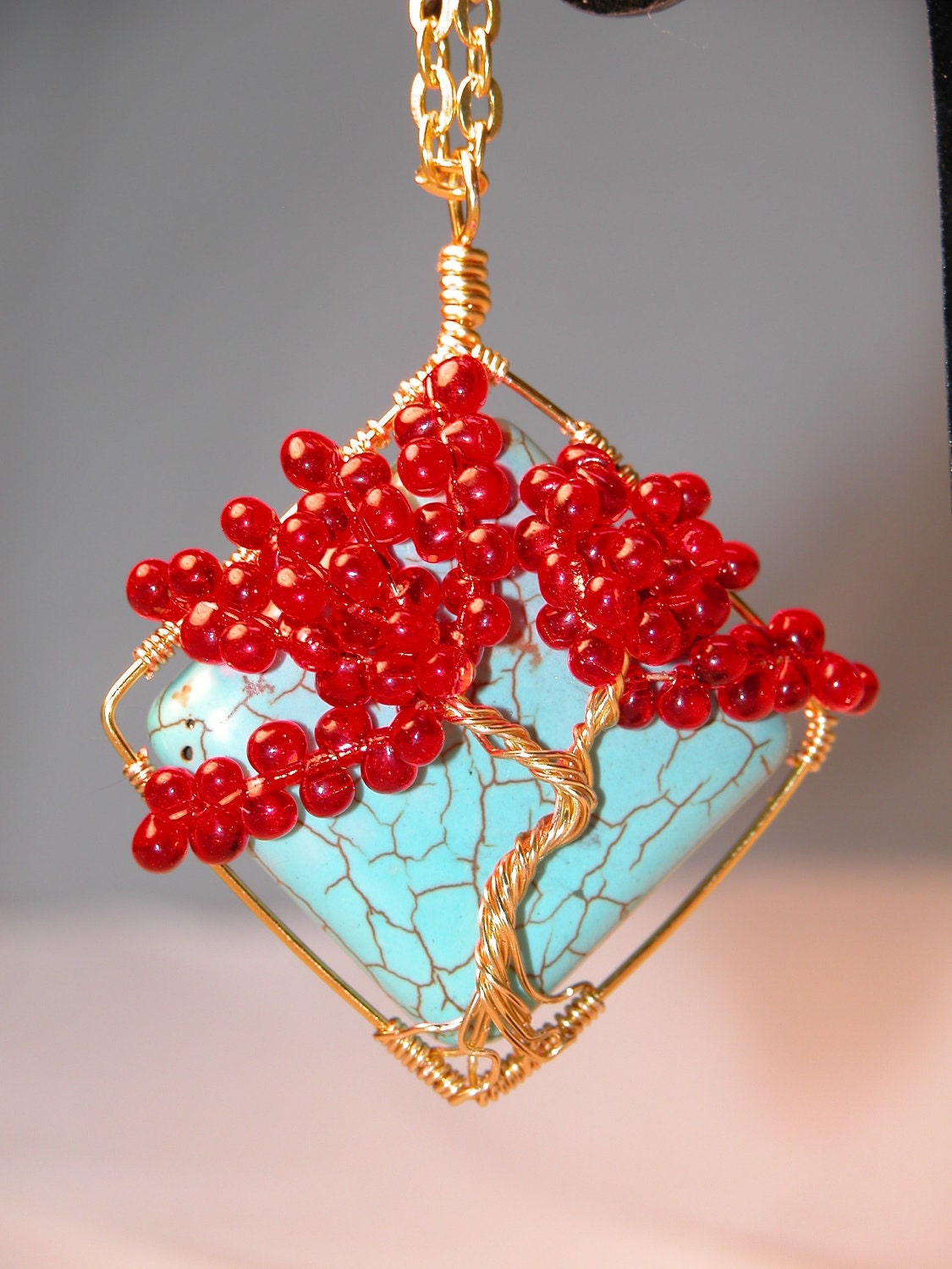 Red and Gold Tree Of Life Wire Wrapped Onto A Aqua Bead Pendent