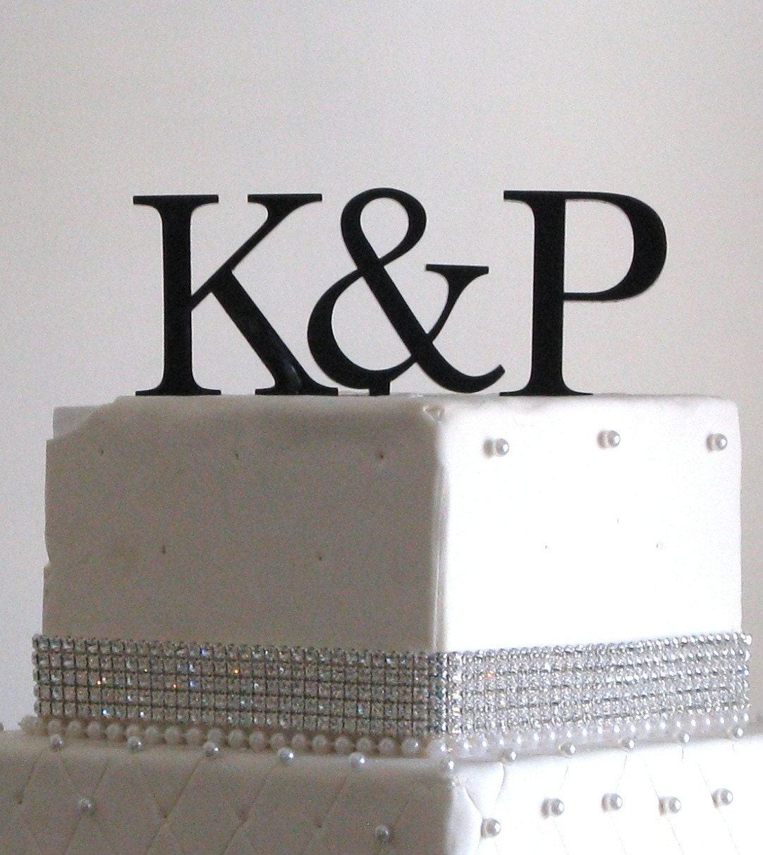 This Two Initials Cake Topper comes with Bride and Groom's First Name