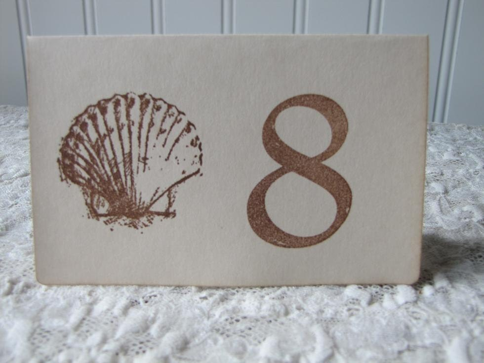 If you want unique hand made table numbers for your wedding this scallop