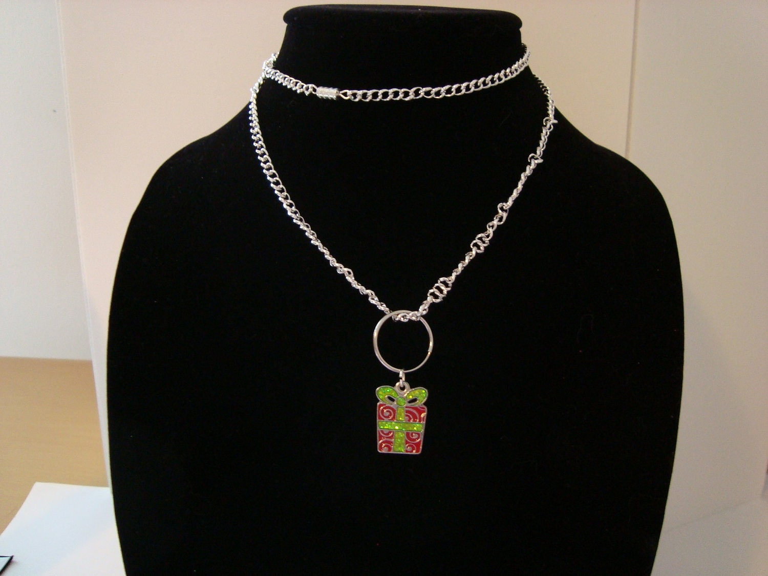 Holiday gift charm on silver chain necklace