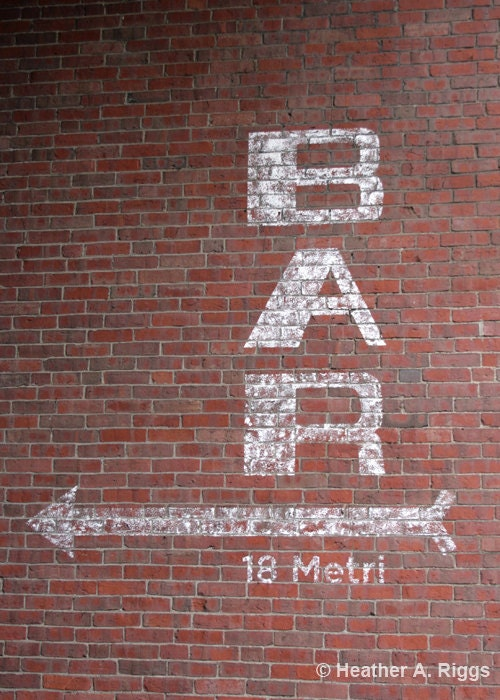 White Bar Sign on Red Brick Photograph