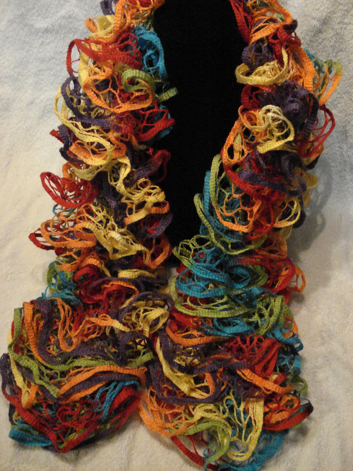 Colorful, soft hand knit ruffle scarf