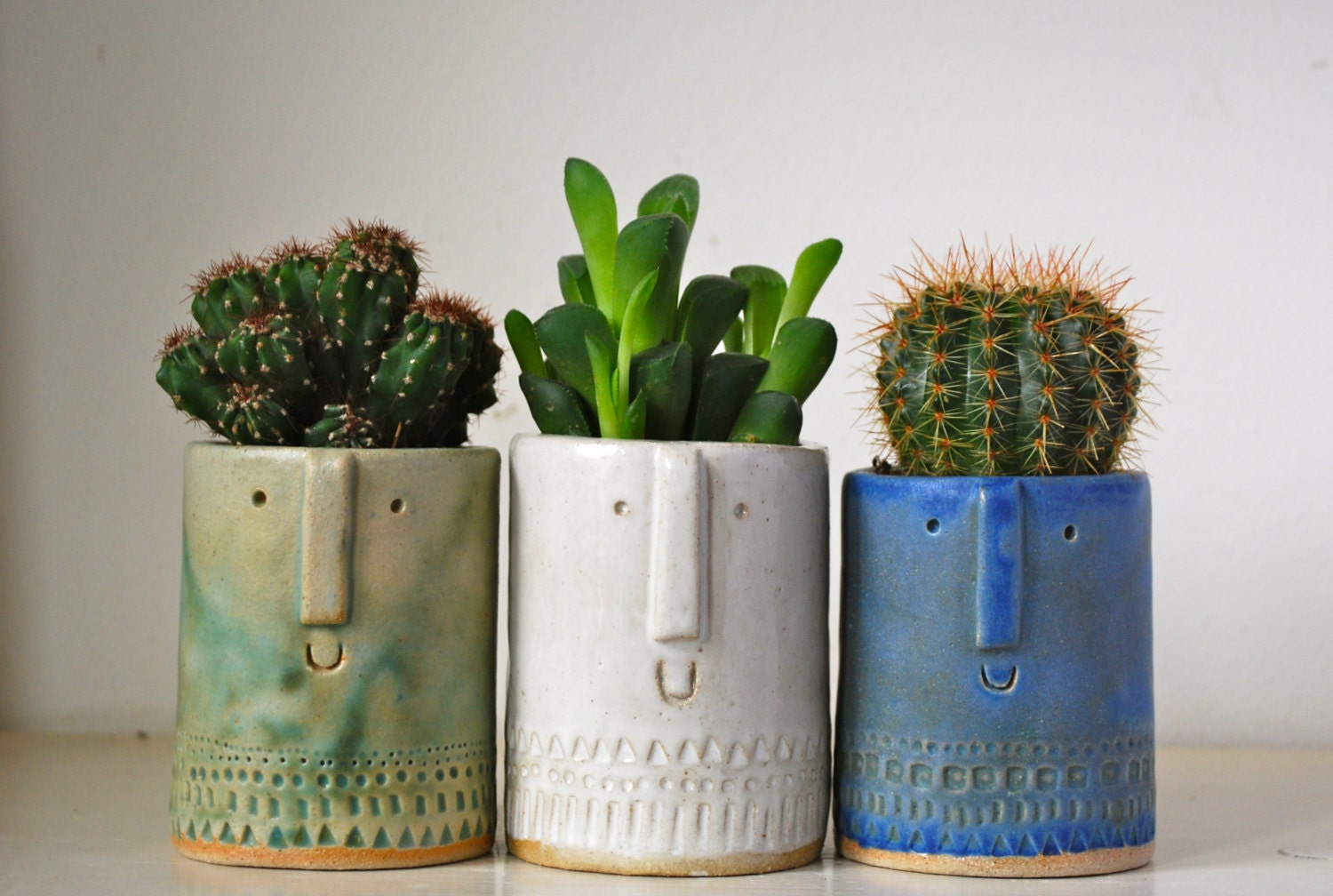 Little succulent or cacti pot in matt green glaze