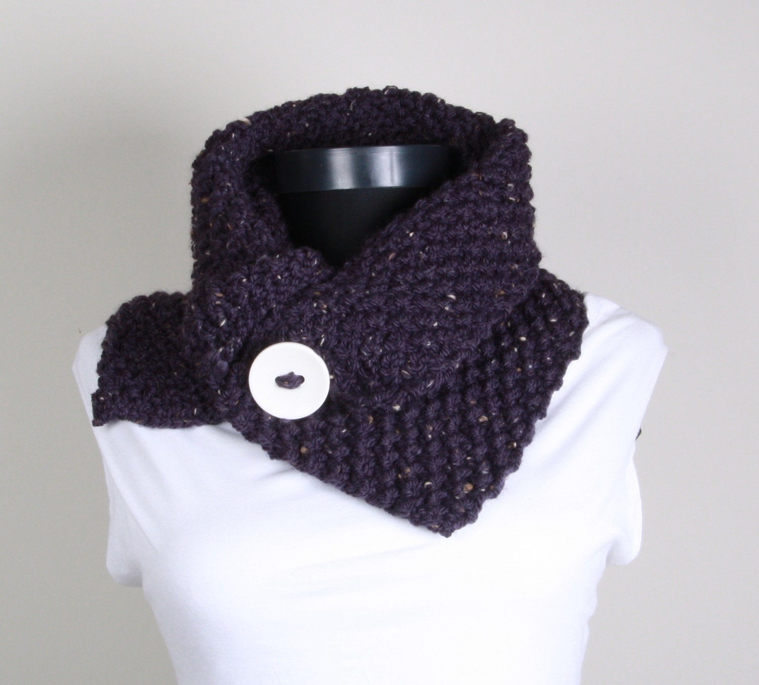 Purple knitted neckwarmer with big white button