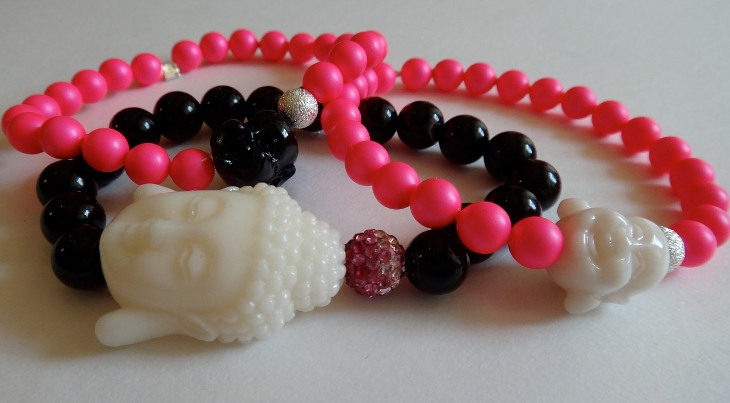 Black Beaded Bracelet with White Buddha and Pink Ombre Crystal Bead