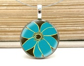 chic blue flower necklace on repurposed coin pendant