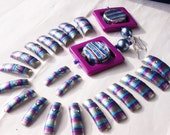 "purple and blue nail art tips matched with earrings ""striata"" first in the world, italian style."