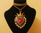 Unusual circus-style colourful heart-shaped locket on an antique-brass-tone chain