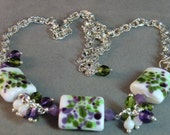 Green and purple Monet's Garden lampwork necklace in white and silver, purple, green, and white lampwork necklace - wilywolverine