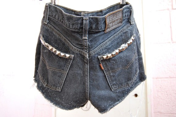 used studded black levis cut offs