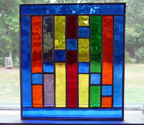 Stained Glass Panel in textured, vibrant blue and rainbow colors