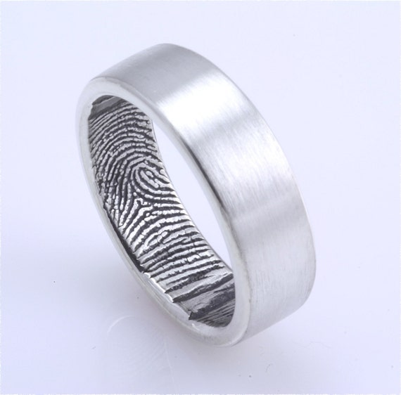 Fingerprint Wedding band The partner 39s fingerprint is engraved on the inside