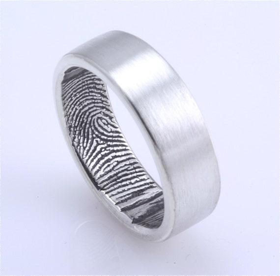 Fingerprint Wedding band The partner 39s fingerprint is engraved on the inside