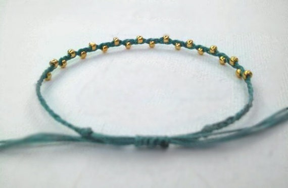 riley. dainty layering friendship bracelet gold beads on adjustable cotton cord