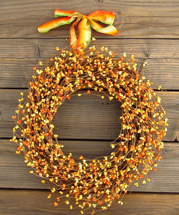 Orange berry wreath for fall