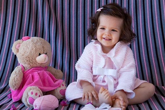 دست کودک بولرو در صورتی ظریف کشباف