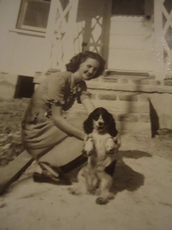 Vintage Black and White Early 1940s Photo of a Woman and her Puppy