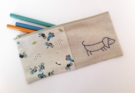 Sausage dog pencil case or zipper pouch. hand embroidery in blue with rockets linen cotton blend fabric
