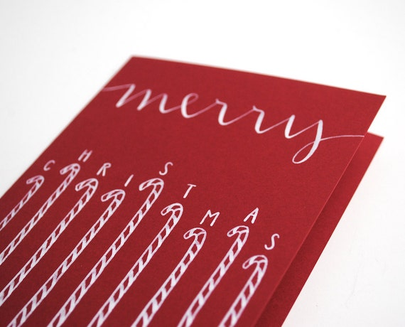 Merry Christmas Greeting Card . Handwritten Calligraphy with Candy Canes . White Ink on Red . Single