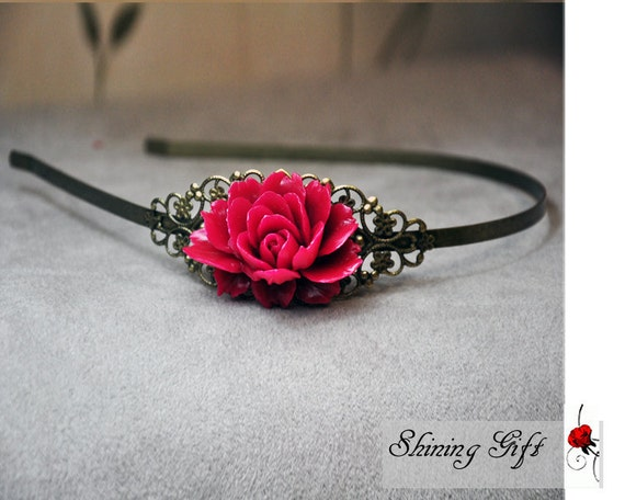 Vintage style antiqued brass headband with resin flower