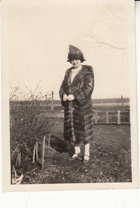 Vintage/Antique photo of a woman in a fur coat and interesting hat