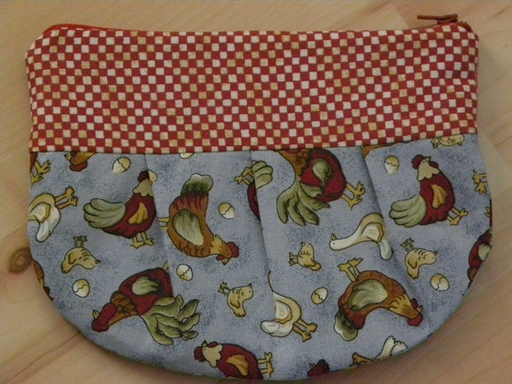 zippy pouch/change purse/makeup bag/ whatever you want to put in it